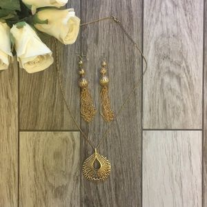 Long gold medallion necklace and long earrings